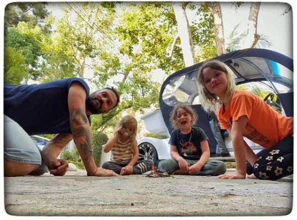 Bodhi Ransom Green with his brothers and father and brothers camping