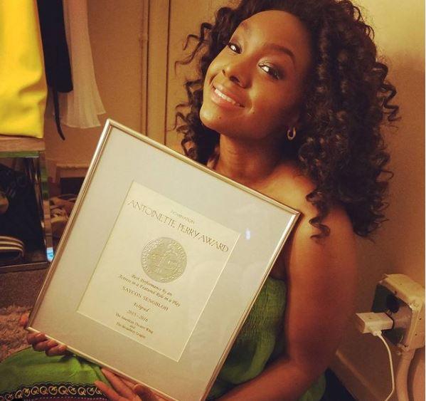 Saycon Sengbloh showing off her Tony Award