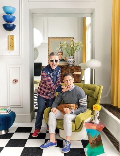 Simon Doonan with his husband, Jonathan Adler and pet