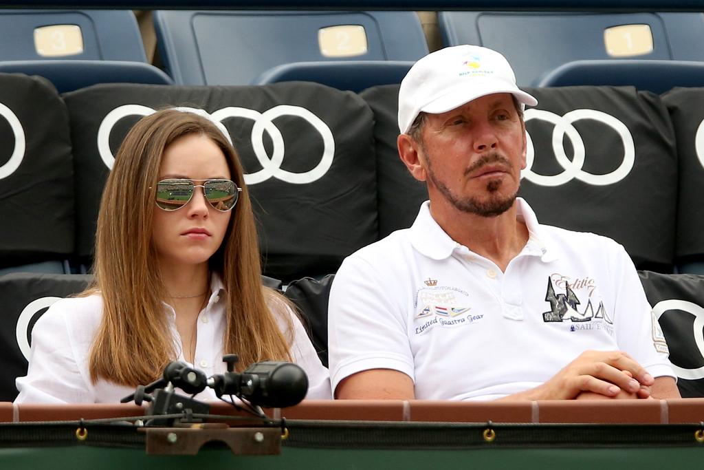 Nikita Kahn enjoying tennis with Larry Ellison