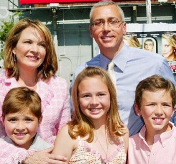 Susan Pinsky with her triplets and husband